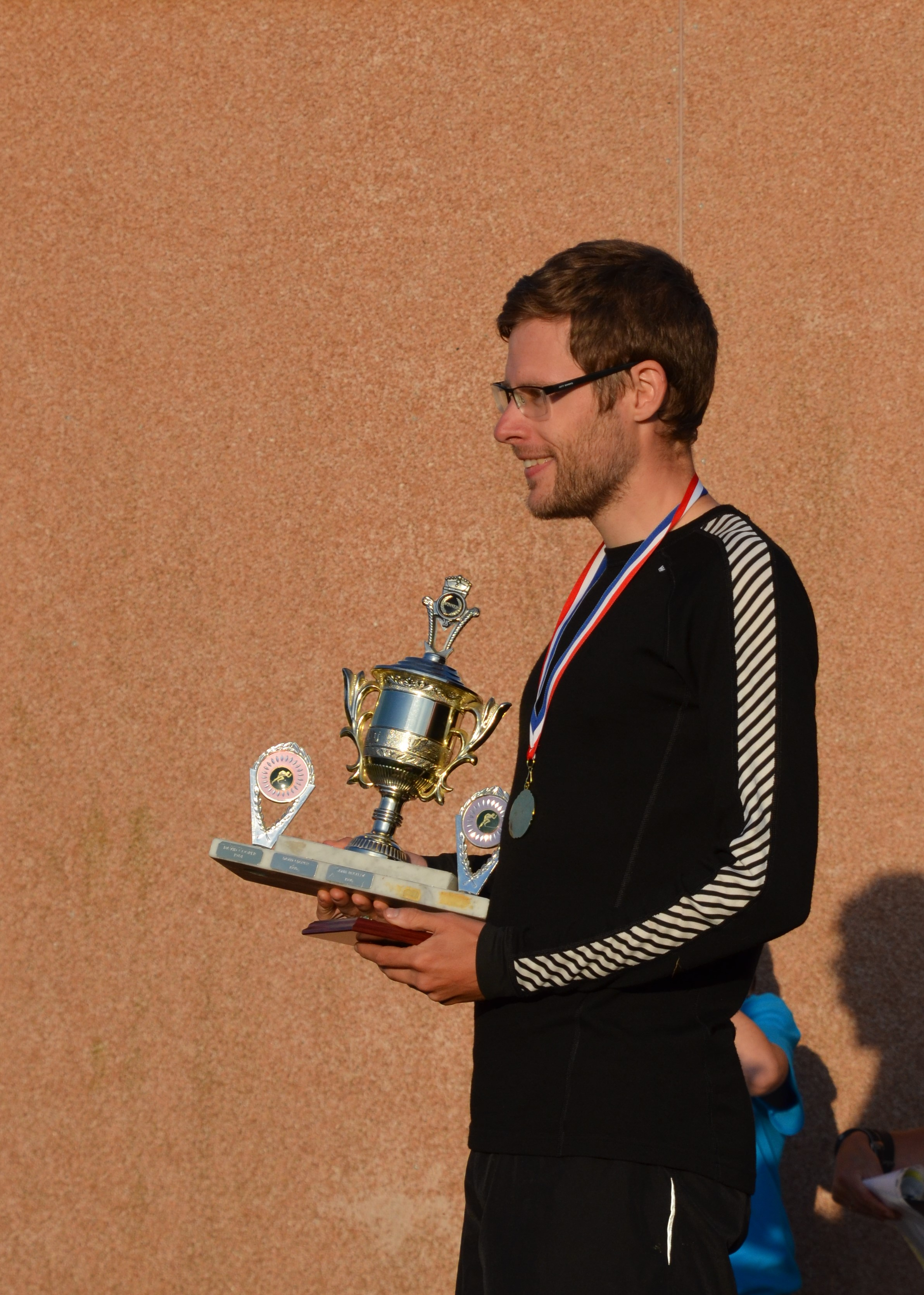 Winner holding trophy